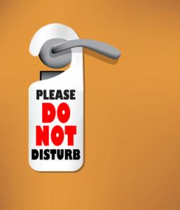 Wood door with a Do not disturb sign